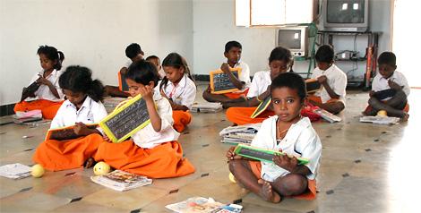 Orphan children in classroom